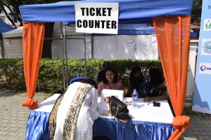Volunteers at the ticket counter help a visitor out