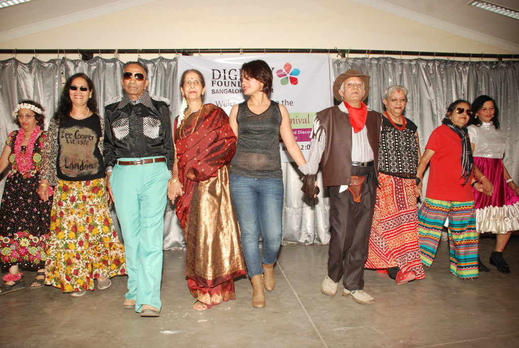 Harini (third from right) & her daughter Varsha (centre) walk the ramp with others