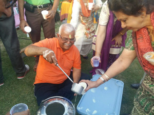 Members make an distribute Thandai