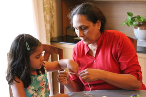 Aruna Pai initiating her granddaughter into learning crochet
