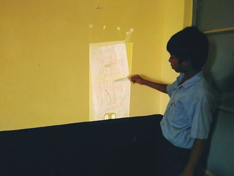 A student projects his work. Photograph courtesy: https://www.facebook.com/meghshala/?fref=ts