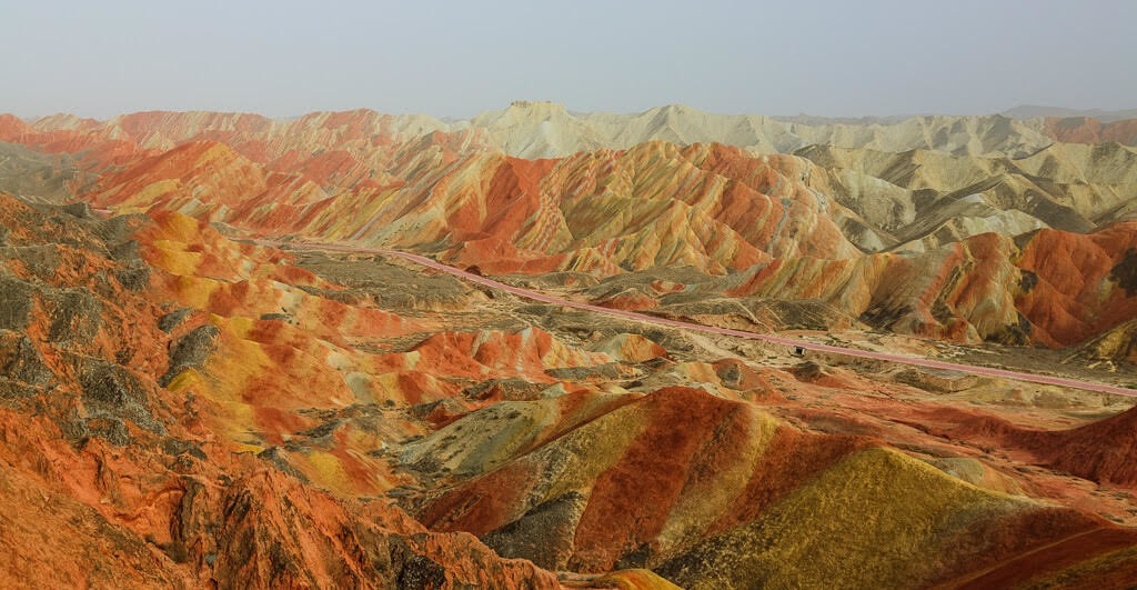 The couple drove through a variety of landscapes. Here is the Zhangye Danxia Landform in China